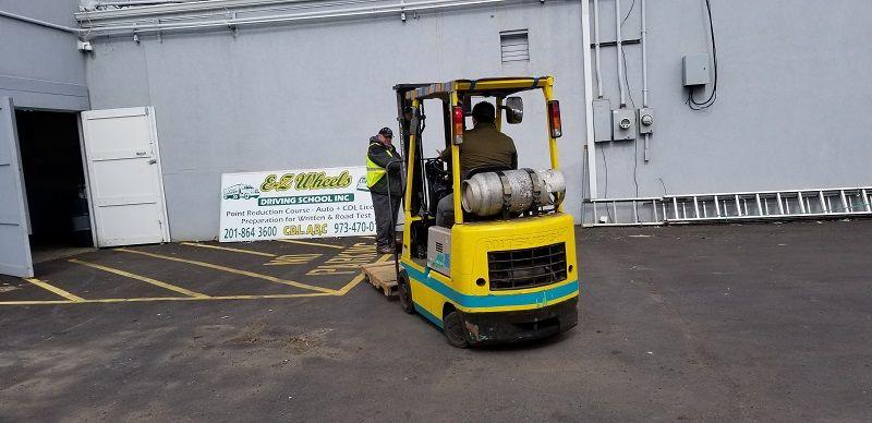 Corporate Client Services Forklift Compressor Ez Wheels Driving